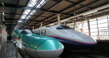 Shinkansen series E5 besides series E2 at Morioka station