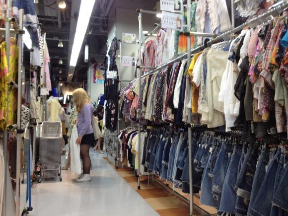 A customer browses through clothes at Kinji