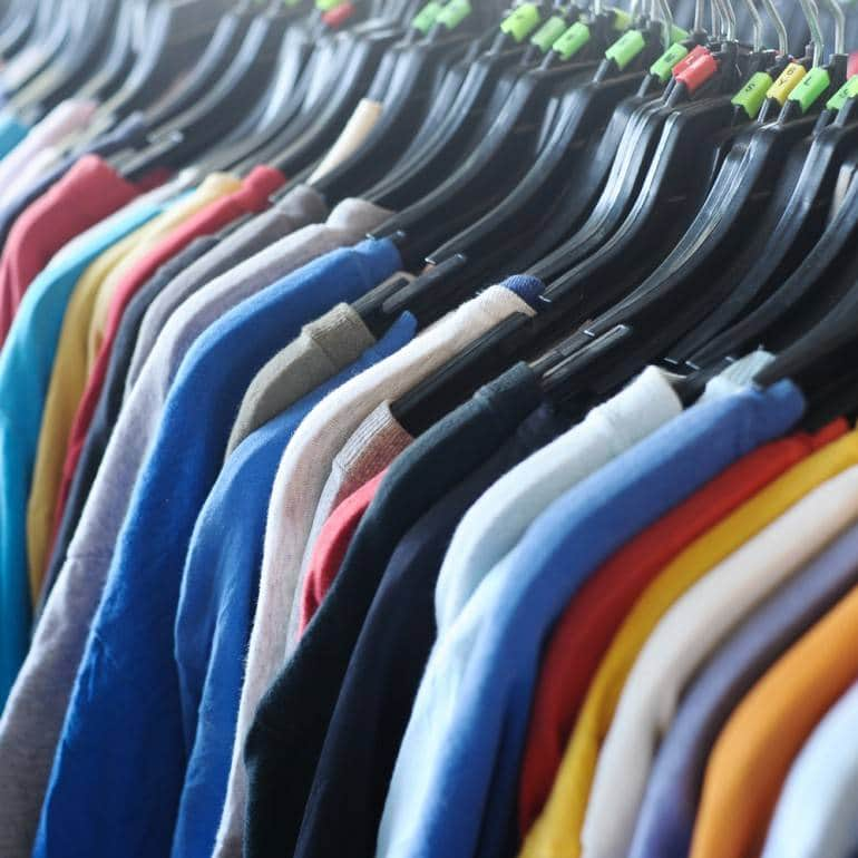 Second-hand clothes pic via Shutterstock.