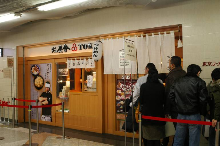 One of the many ramen stores in Tokyo Ramen Street. You might have to queue - it's a popular place! Pic by lazy fri13th, used under a Creative Commons licence.