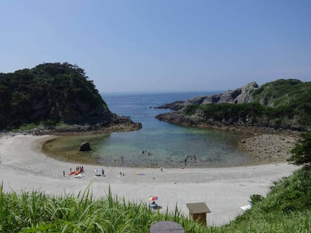Featured in the travel posters adorning Tokyo's JR line, Tomari Beach looks sandier from a distance than it actually is. The tide-pool rimmed, rocky-bottomed shallow bowl is rich with fish, crabs, sea biscuits, and sea weed.