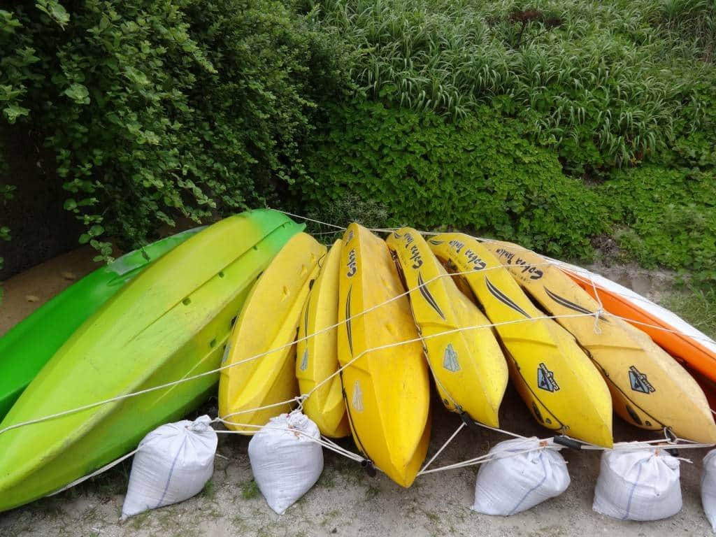 Ocean kayaks await the mildly adventurous on Oura Beach.