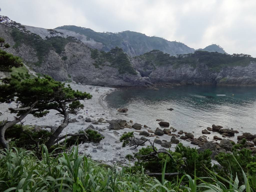 A jungly stone path leads to Nakanoura's pine-scented beach cove that rewards snorkelers.