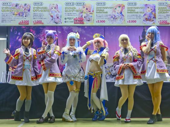 Comiket 95. Models stand in a row on stage.