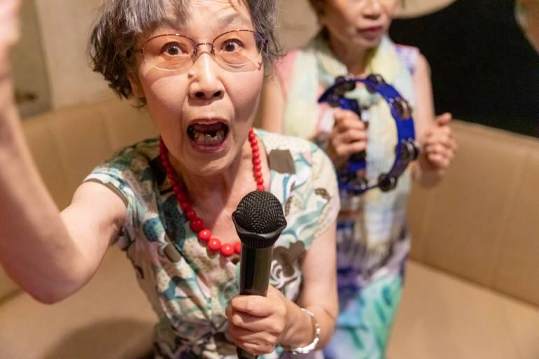 Senior women enjoying Karaoke
