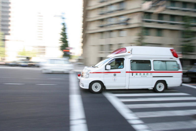 """An ambulance, or """"kyūkyūsha"""", rushing through the streets of Tokyo"""