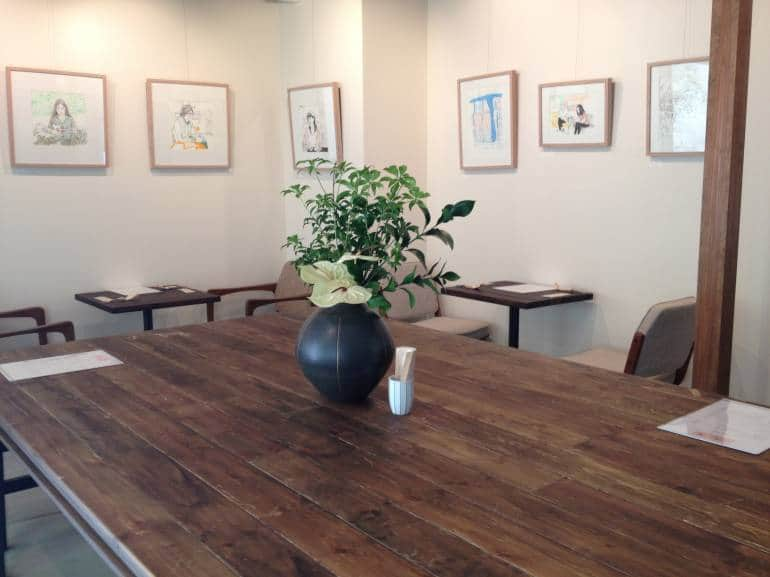 The main dining area featuring monthly exhibitions from local artists.