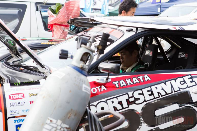 Max Orido making some adjustments. Several drivers also race in JGTC and SUPER GT.