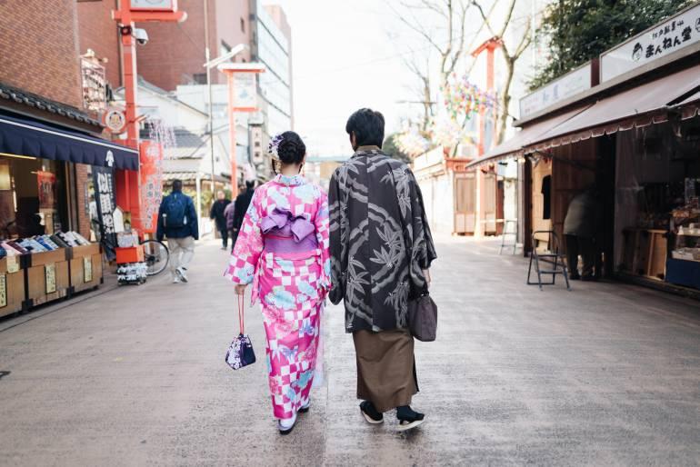 Couple in kimono holding hands