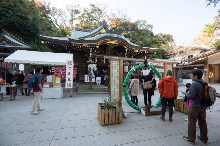 People at Enoshima Shrine in Enoshima, Fujisawa, Kanagawa Prefecture, Japan. The shrine is dedicated to the worship of the Benten.