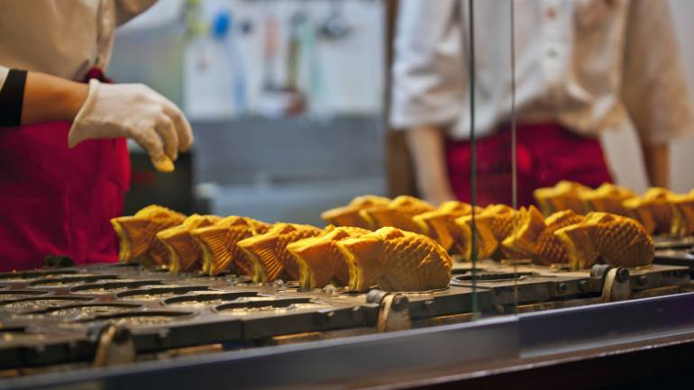 Taiyaki is Japanese fish shaped cake filled with sweet red bean paste.
