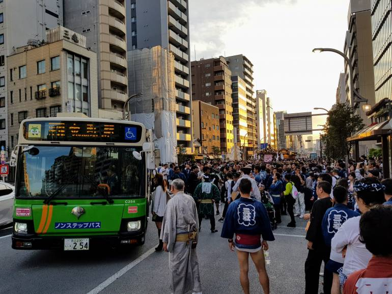 A Toei Bus pulls over during the Sanja Matsuri in Asakusa