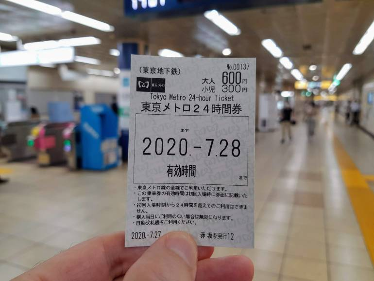 A 24 hour Tokyo Metro ticket held up inside a Tokyo Metro Station