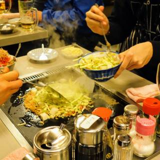 Tsukishima Monja Street: A Taste Triathlon