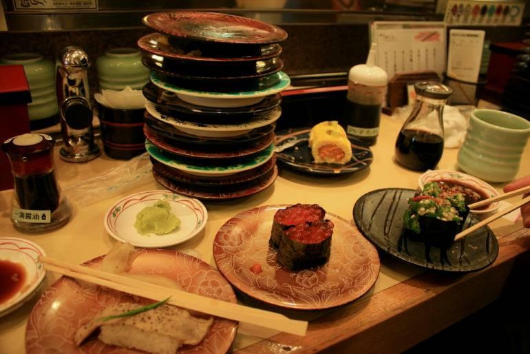 Pile of sushi plates.