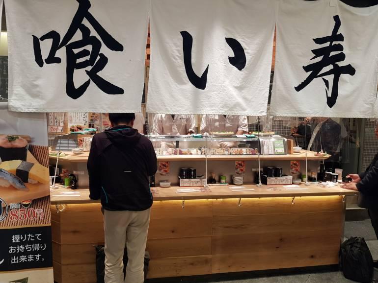 Uogashi standing sushi  customer