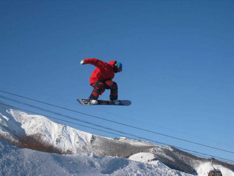 a person snowboarding at Hakuba