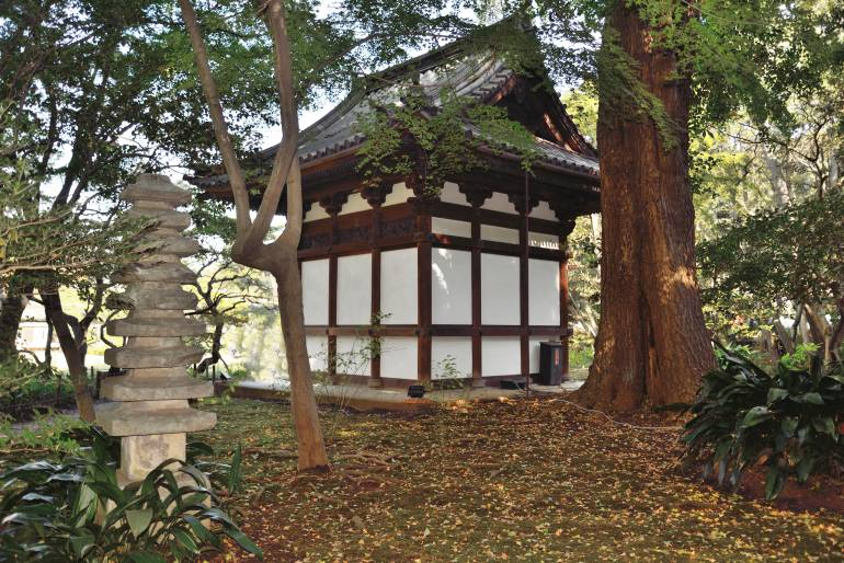 The Juto Oido of Old Tenzuiji located in Sankeien Garden, a structure built in 1591, to house a stone monument to celebrate they shogun's mother's health and long life.  The stone tower in the foreground is just one of many throughout the garden.
