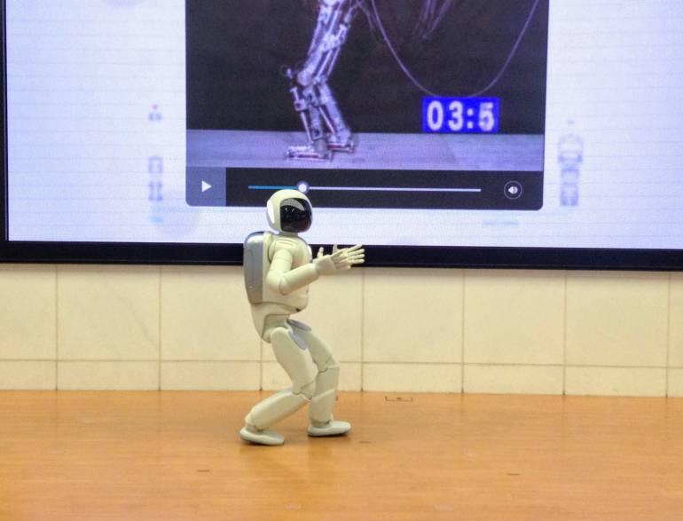 Asimo robot walking on stage at the Nissan showroom