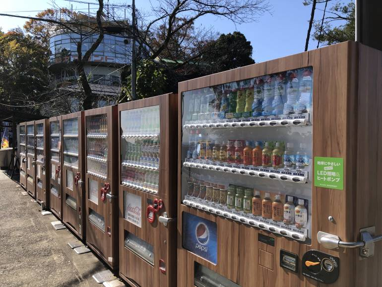 a line of brown-colored vending machines at the middle observation area of Mount Takao, Tokyo