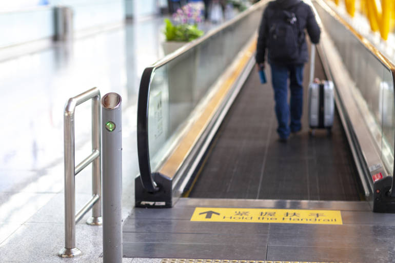 traveler walking from arrivals at haneda airport to transfer to tokyo