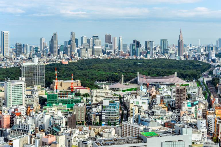 The tall buildings of Shinjuku with Yoyogi Park in the foreground.