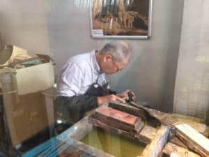 Kamata repairing a knife