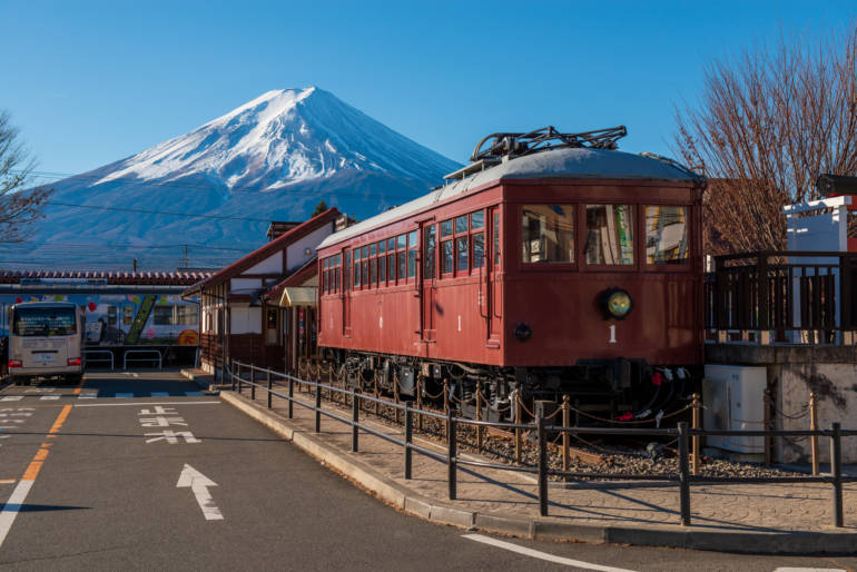 kawaguchiko station near mount fuji, with train in foreground