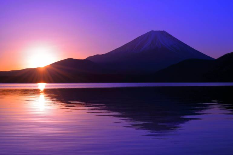 Sunrise over Lake Motosu with Mt. Fuji reflected in the water