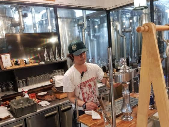 Staff pouring beer at Yokohama Brewery