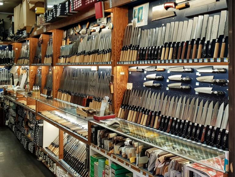 Interior of Tsubaya, knives displayed on wall shelves
