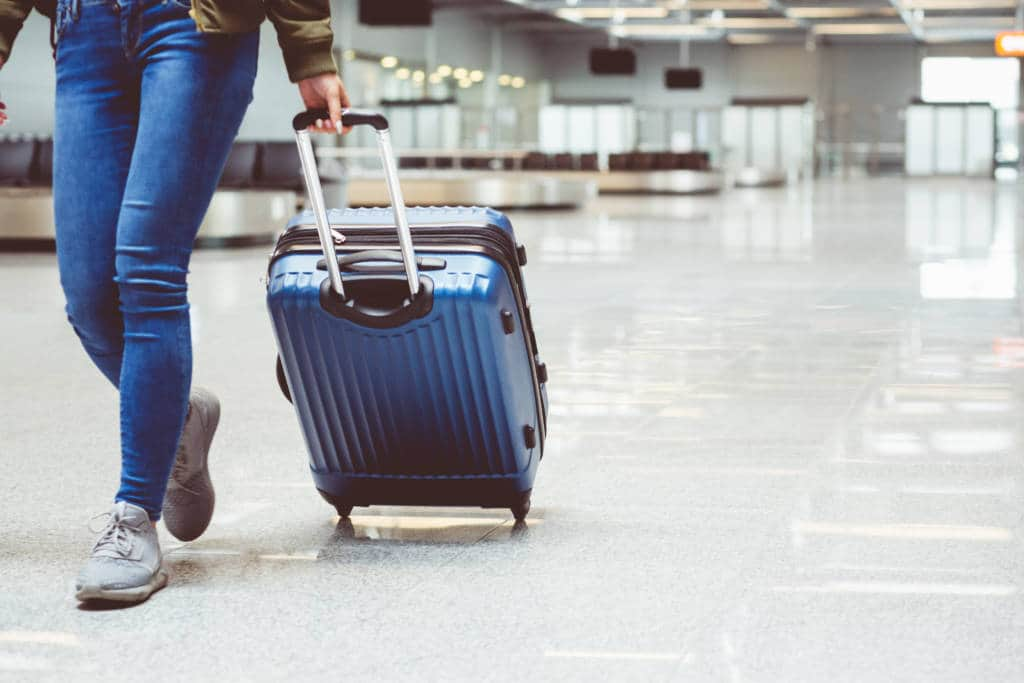 Walking with luggage in an airport