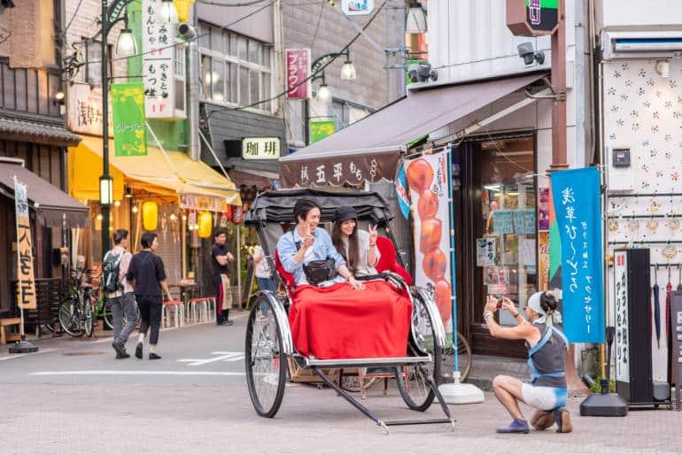 Tokyo Rickshaw driver takes photo of tourist couple