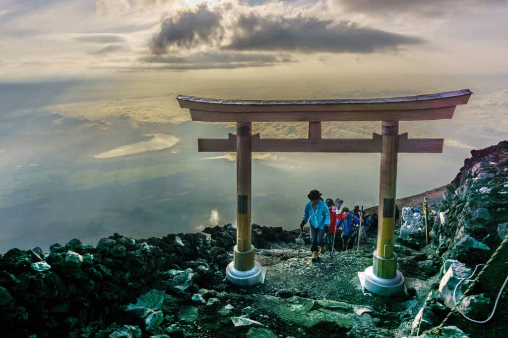 MOUNT FUJI, YAMANASHI, JAPAN - July 25, 2017 : Torii on top of Fuji mountain . Fuji is highest mountain in Japan at 3,776 m, symbol of Japan