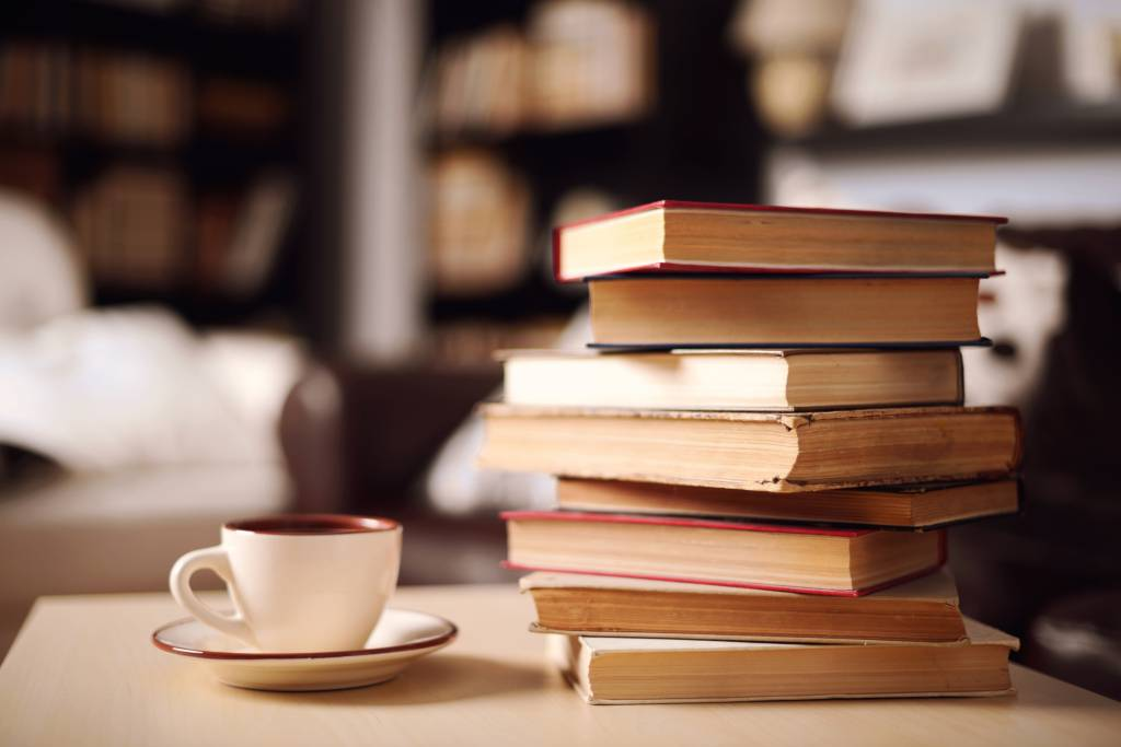 stack of books and coffee