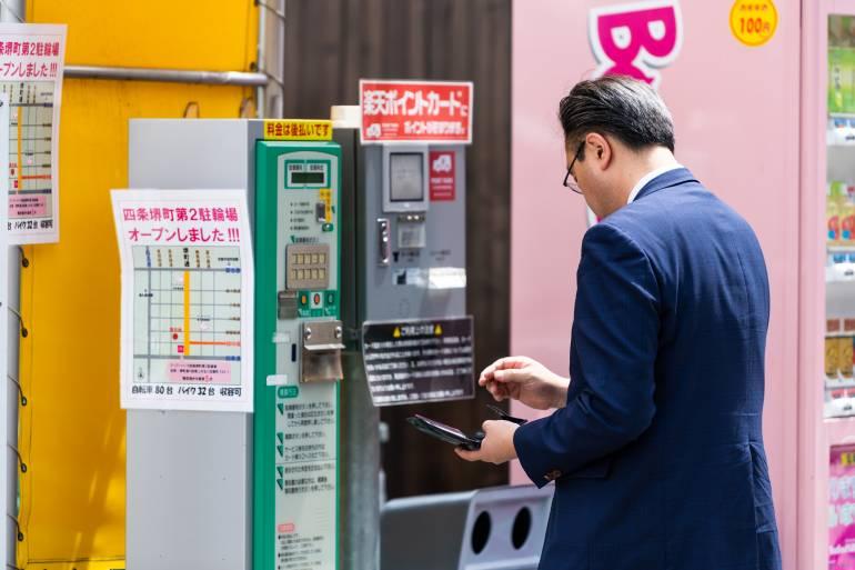 Man paying parking fee