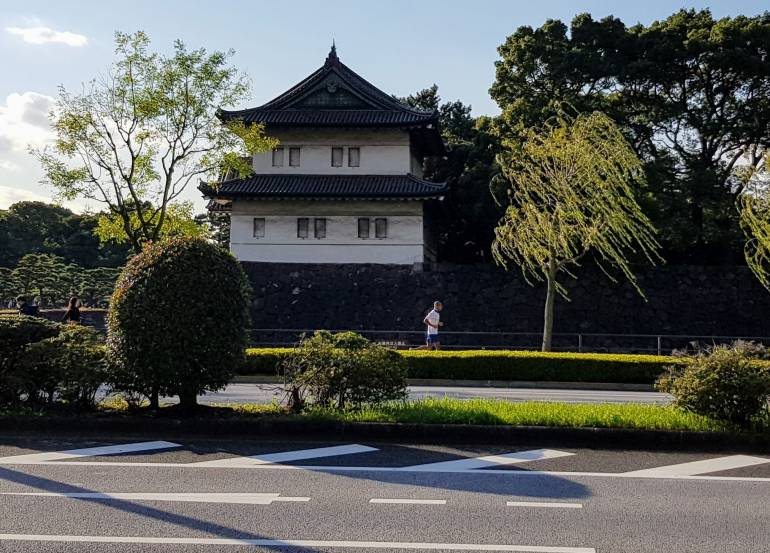 Jogger passes in front of a building of the Imperial Palace