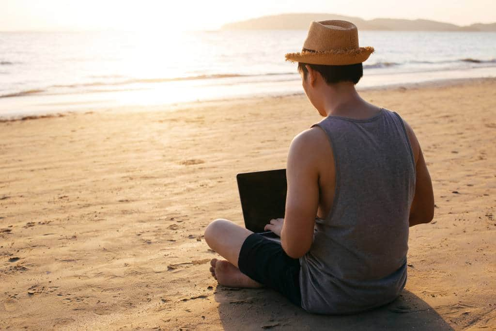 digital nomad on beach