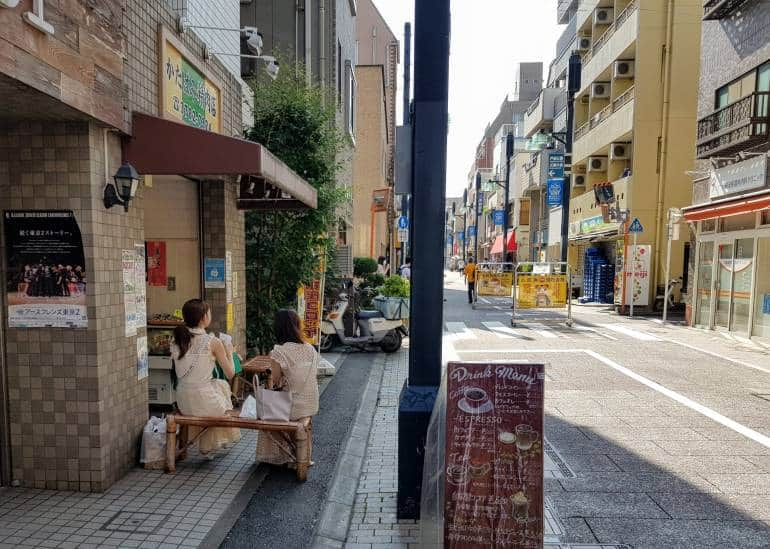 Two women enjoying a refreshment on Togoshi Ginza