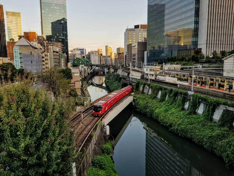 Marunouchi Line train emerges onto bridge over the Kanda River next to Ochanomizu Station