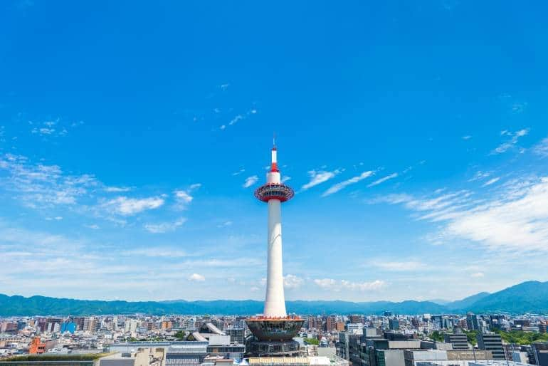 Kyoto Tower against a blue sky