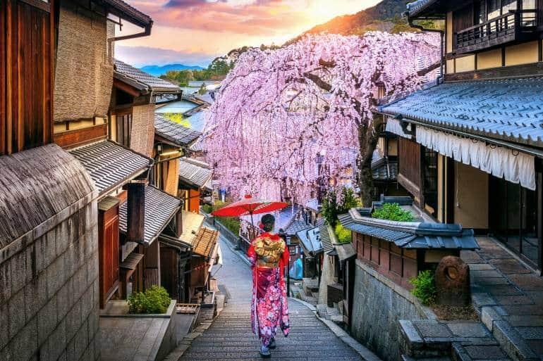 Woman wearing japanese traditional kimono walking at Historic Higashiyama district in spring, Kyoto in Japan