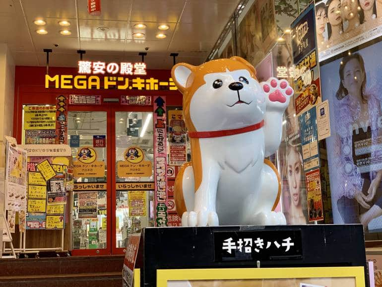 Cartoon Hachiko statue in front of Mega Donki in Shibuya