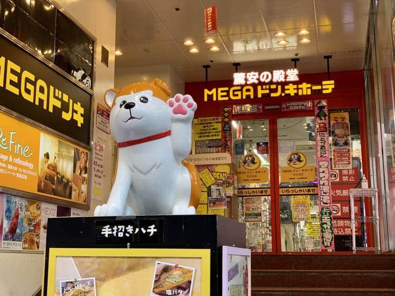 Cartoon Hachiko statue in front of Mega Donki in Shibuya