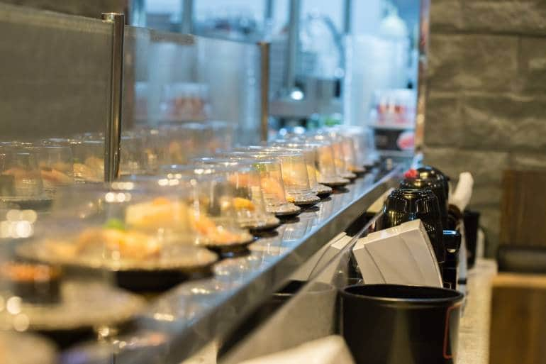 row of revolving sushi dishes