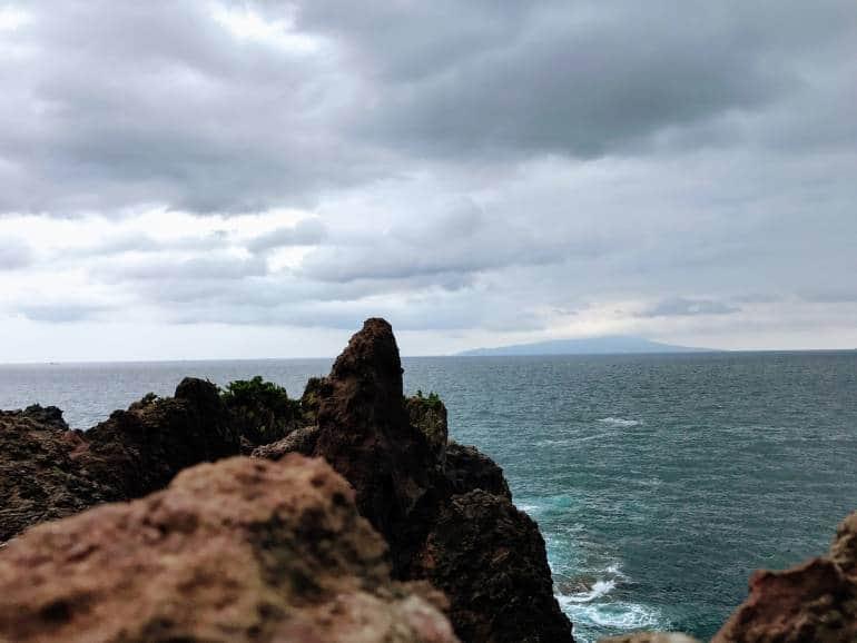 Izu's volcanic coast with sea in background