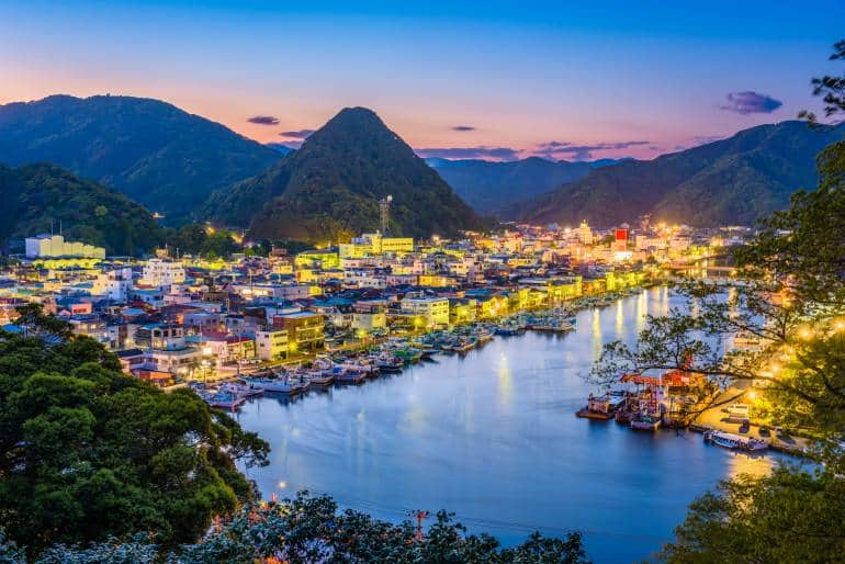 Shimoda skyline with mountains in background at dusk