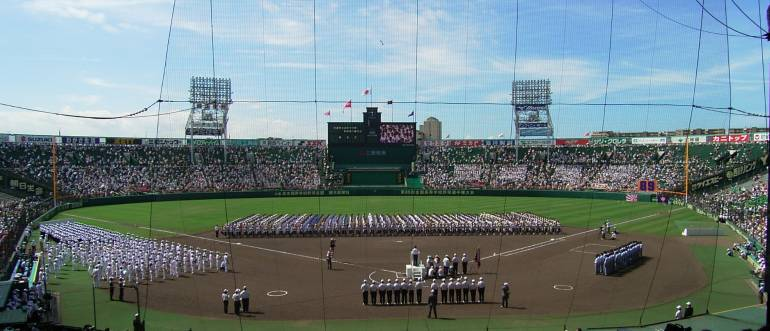 All the participants of th Koshien Summer Tournament line up for a ceremony.