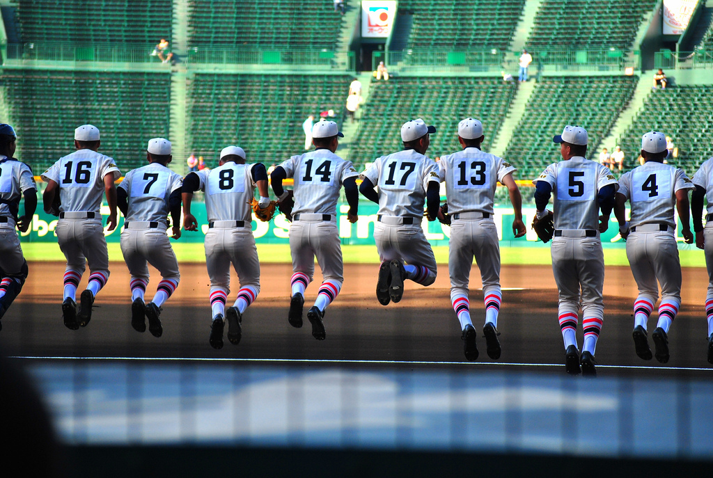 A baseball team warms up
