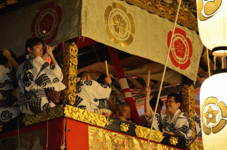 A Gion Matsuri float filled with musicians